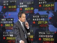 Criza nucleara din Japonia a contaminat bursele din intreaga lume. Rezultatul: scadere pe linie