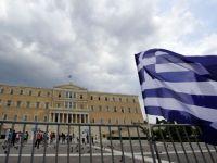 FMI ar putea plati de urgenta urmatoarea transa din imprumutul pentru Grecia. Cativa investitori cred ca statul elen ar putea intra in incapacitate de plata