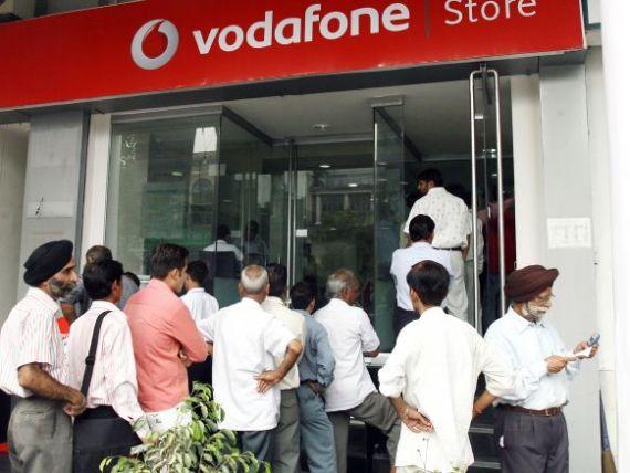 Vodafone plateste 5,4 mld. de dolari pentru 33% din actiunile unei companii indiene