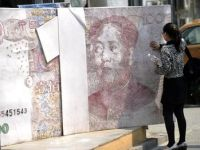 Euro, aurul si petrolul, influentate negativ de majorarea dobanzii cheie in China