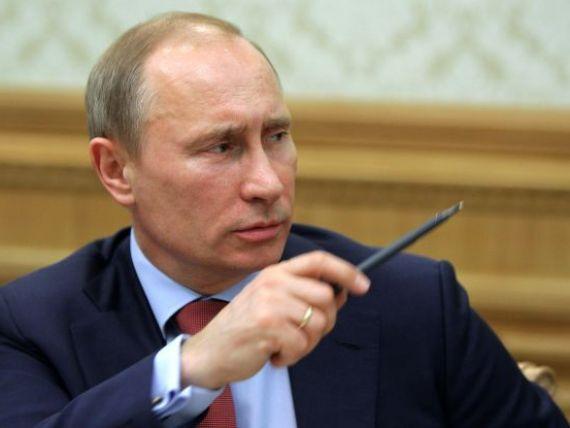 Putin ataca tiparnita de bani a SUA:  Se comporta ca niste huligani, inunda intreaga lume cu dolari