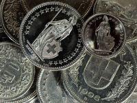 Din nou emotii pentru cei cu credite in franci. Moneda elvetiana isi contina aprecierea, investitorii stau cu ochii pe SUA si Germania
