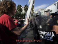 Grecia ia in calcul restructurarea partiala a datoriei sale gigantice de 350 de miliarde de dolari. Bursele au inchis pe minus