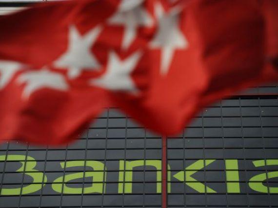 Institutiile de credit spaniole, la pamant. S P a retrogradat intreg sectorul bancar din Spania