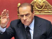 Berlusconi se preda. Dupa ce a negat ca are probleme, Italia a acceptat sa fie monitorizata de FMI si UE