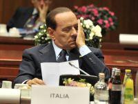 Somn si politica: Italia este pe marginea prapastiei, iar Berlusconi tine cu dintii de putere. Cum a adormit, de doua ori, premierul la summit-ul de la Cannes