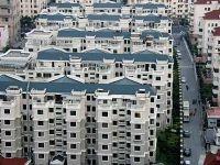 Culmea crizei la chinezi: cine cumpara un apartament primeste un BMW gratis