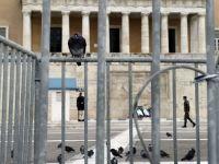 Guvernul grec a aprobat programul de restructurare a datoriilor. 107 mld. euro vor fi sterse din contul obligatiilor financiare