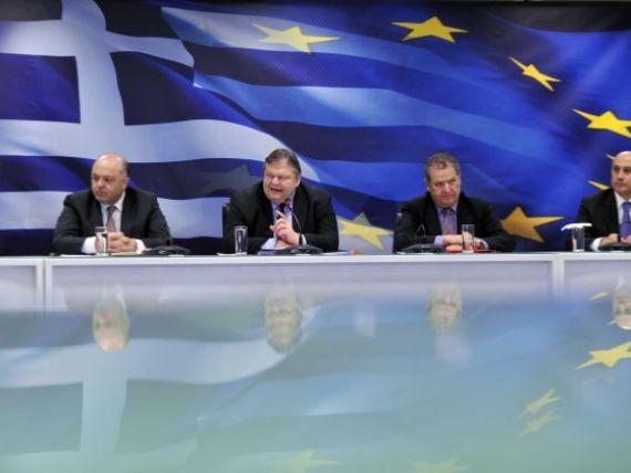 Grecii platesc scump pentru cele 130 de mld. euro de la FMI si CE. Atena a aprobat un nou plan de reducere a salariilor si a pensiilor