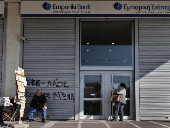 Prima banca greceasca, scoasa la licitatie. Cei 3 jucatori interesati de achizitia Emporiki Bank