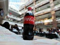Coca-Cola se vinde bine. Compania raporteaza profit peste asteptari, pe trimestrul al doilea