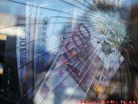 Cat ar costa spargerea zonei euro. Exit-ul Spaniei si Italiei ar cufunda intreaga lume in recesiune