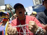 """Sute de manifestanti cer """"adevarul"""" despre starea de sanatate a lui Hugo Chavez"""