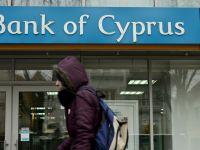 Bank of Cyprus Romania ramane inchisa inca doua saptamani. Negocierile pentru preluare incep astazi
