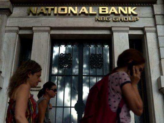 UE si FMI schimba strategia in Grecia. Fuziunea NBG-EFG Eurobank a fost suspendata, actiunile celor doua banci scad cu 30%