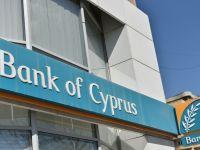 Banca Centrala din Cipru a respins ofertele BT si Raiffeisen pentru preluarea Bank of Cyprus Romania