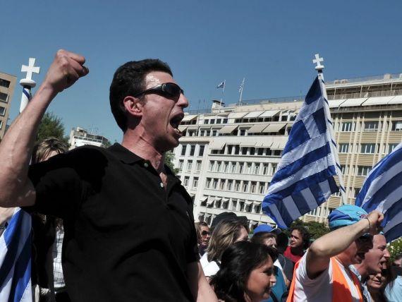 Grecia va putea confisca banii din banci ai populatiei si firmelor cu datorii la Fisc