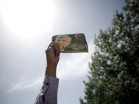 Sectiile de votare s-au deschis in Iran pentru alegerile prezidetiale