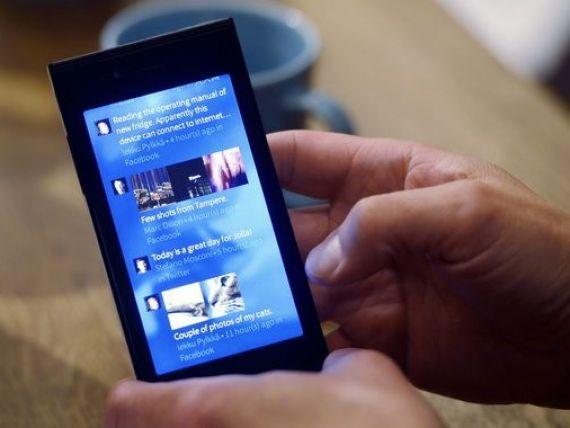 Publicitatea pe dispozitivele mobile a adus gigantului Google profit peste asteptari in trim. III. Actiunile depasesc, pentru prima data, 1.000 dolari