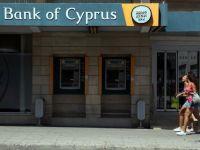 Bank of Cyprus s-a recapitalizat, dar obliga in continuare deponentii sa pastreze bani la banca