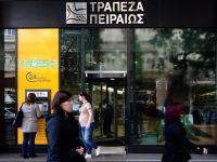Miliardarul John Paulson si mai multe fonduri de hedging americane investesc in bancile din Grecia