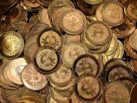 Romanii, din ce in ce mai atrasi de banii care nu exista. Cum se obtine moneda virtuala bitcoin si ce se poate cumpara cu ea