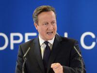 Premierul britanic face presiuni la Bruxelles pentru a limita accesul muncitorilor din UE