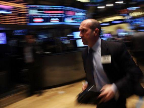 Fed a redus achizitiile lunare de obligatiuni cu inca 10 mld. dolari, continuand programul de retragere a masurilor de stimulare a economiei. Turbulente pe pietele emergente