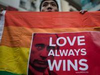 JO de la Soci: Mai multe companii media din lume si-au modificat logourile pentru a sustine persoanele gay. FOTO