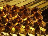 Pretul aurului scade la cel mai redus nivel din ultimele doua luni, in timp ce dolarul castiga teren