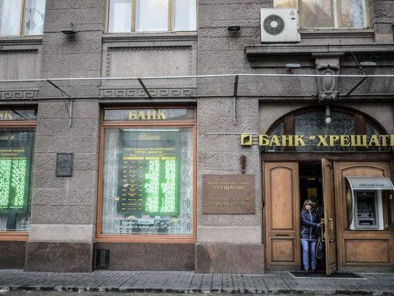 Banca Ucrainei a crescut puternic dobanda luni noapte, pentru a sustine grivna. Analisti:  Nu va opri declinul monedei, cel mai accelerat din lume