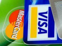 Medvedev ameninta ca va pedepsi Visa si MasterCard pentru participarea la sanctiunile impuse de SUA. Rusia vrea sa-si faca propriul sistem de plati electronice