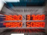 Euro a atins minimul ultimei luni fata de dolar, dupa declaratiile de joi ale sefului BCE