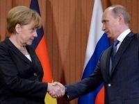 Ipoteza soc in presa de la Londra: Merkel si Putin negociaza in secret un plan de pace in Ucraina. Ce promite Europa Rusiei, in schimbul gazelor