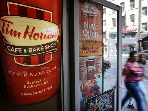 Burger King cumpara cafenelele Tim Hortons pentru 11 mld. dolari, devine al 3-lea cel mai mare lant de fast-food din lume si scapa de taxele mari din SUA. Tranzactia, partial finantata de Buffet