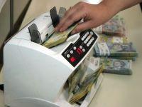 """Bancile critica numarul mare de proiecte de lege aflate in dezbatere, """"daunatoare"""" sistemului"""