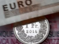 Francul elvetian a scazut cu 3 bani, la 4,1611 lei. Moneda nationala s-a depreciat usor fata de euro