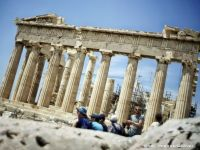 """FT: Acord istoric pentru reducerea datoriei Greciei, după trei programe de asistență financiară pentru a evita falimentul. Comisar UE: """"Criza elenă se încheie în această noapte"""""""