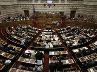 Parlamentul Greciei a aprobat acordul cu creditorii internationali pentru al treilea plan de ajutor. Eurogrupul se reunseste astazi pentru discutii pe plan