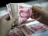 China vinde la Londra obligatiuni denominate in yuani, prima emisiune de actiuni in afara tarii