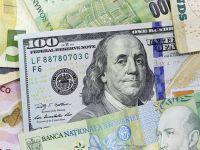 Leul s-a depreciat fata de euro si dolar