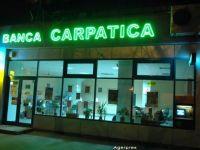Cinci actionari ai Bancii Carpatica vand 20% din actiuni catre Nextebank