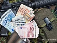 "Bancnota euro care ar putea fi interzisa in UE. Modul in care hartiile ""bin Laden"" trec prin Romania si ajung la teroristi"