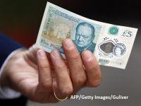 Banca Angliei va continua să folosească grăsimea animală pentru fabricarea noilor bancnote, în ciuda protestelor activiștilor civici