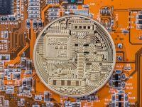 Una din 5 bănci centrale ar putea trece la monede virtuale în următorii ani
