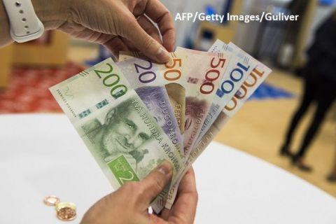 O societate fără bani rămâne o utopie. Suedia, denumită și țara fără cash, obligă bancile să dețină și să ofere clienților bani lichizi