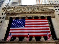 """Bursa de la New York și-a continuat declinul: """"Tendinţa de volatilitate după o zi şocantă ar putea continua."""" Ce îi sperie pe investitori"""
