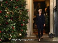 Premierul Theresa May câştigă votul de încredere în Parlament și anunță că va continua punerea în aplicare a acordului pentru Brexit