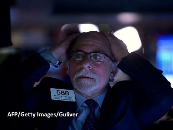 Fed nu a reușit să calmeze piețele. Tranzacțiile de pe Wall Street, suspendate din nou la deschidere, din cauza căderilor masive