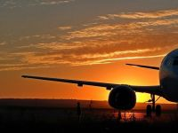 O treime din populația globului, dispusă să renunțe la călătoriile cu avionul, pentru a limita schimbările climatice